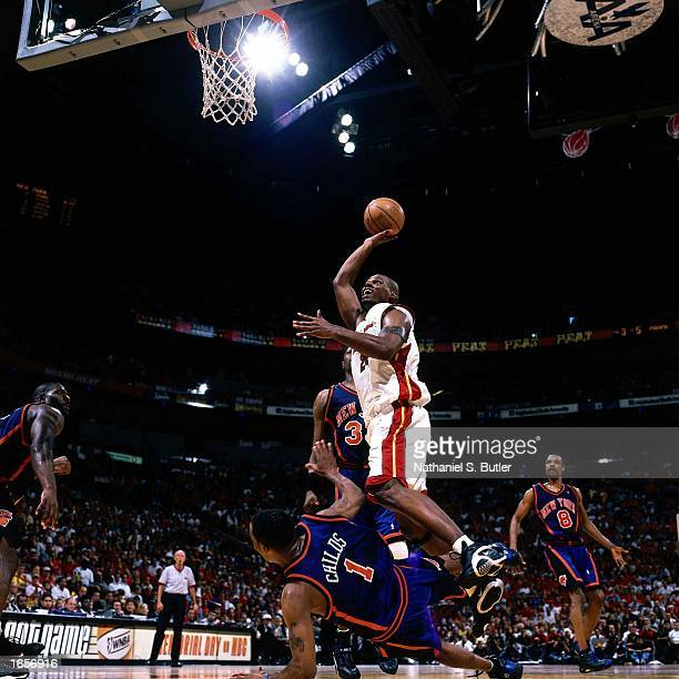 Jamal Mashburn of the Miami Heat drives to the basket against Chris Childs of the New York Knicks during game 7 of the 2000 NBA SemiFinals at...