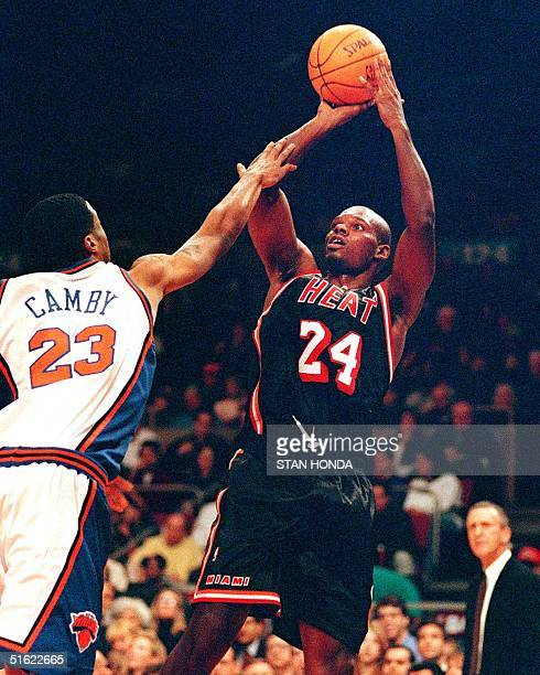 Jamal Mashburn of the Miami Heat shoots over Marcus Canby of the New York Knicks in the second quarter of their game 07 February at Madison Square...