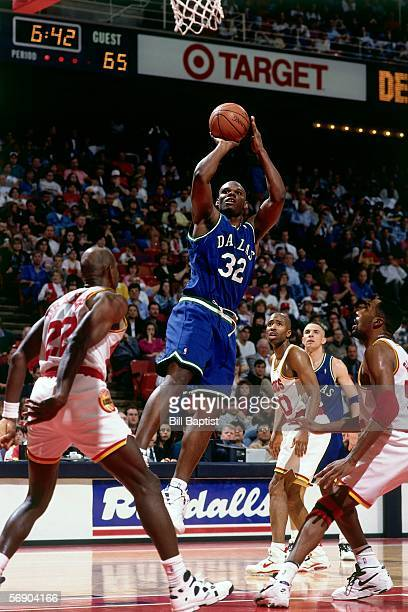 Jamal Mashburn#32 of the Dallas Mavericks shoots a jumpshot in the lane against the Houston Rockets during an NBA game on March 11 1995 at the Summit...