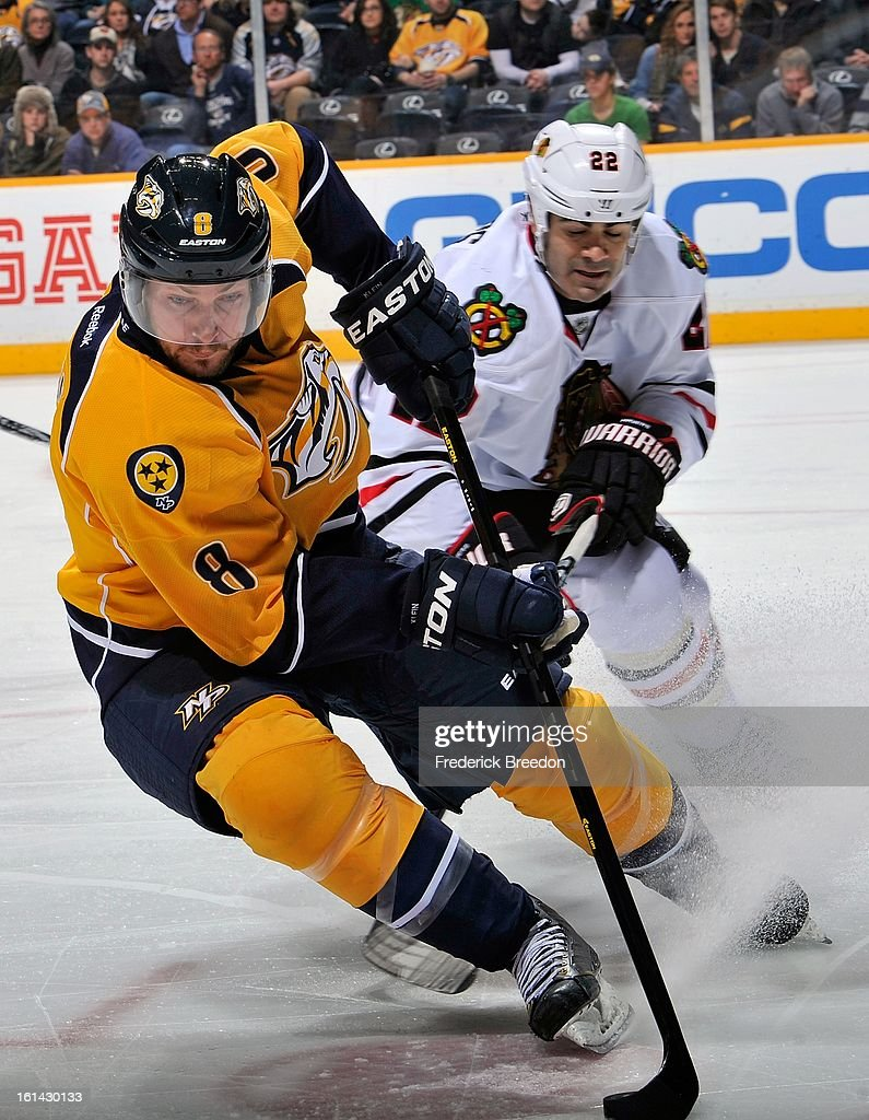 Jamal Mayers #22 of the Chicago Blackhawks pressures Kevin Klein #8 of the Nashville Predators at the Bridgestone Arena on February 10, 2013 in Nashville, Tennessee.
