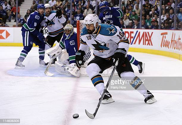 Jamal Mayers of the San Jose Sharks plays the puck around the net in Game Five of the Western Conference Finals against the Vancouver Canucks in the...