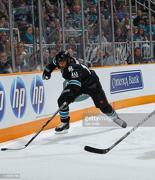 Jamal Mayers of the San Jose Sharks reaches for the puck against the Los Angeles Kings in Game One of the Western Conference Quarterfinals during the...
