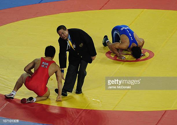 Jamal Mirzaei of Iran celebrates winning Gold against Jaesung Lee of Korea in the Men's Freestyle 84kg class Final at Huagong Gymnasium during day...