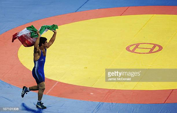 Jamal Mirzaei of Iran wins Gold in the Men's Freestyle 84kg class Final at Huagong Gymnasium during day twelve of the 16th Asian Games Guangzhou 2010...