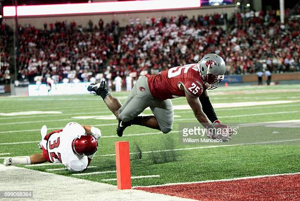 Jamal Morrow of the Washington State Cougars attempts to score a touchdown in the second half against the Eastern Washington Eagles at Martin Stadium...