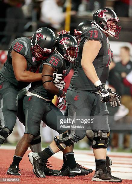Jamal Morrow of the Washington State Cougars celebrates his touchdown against the Oregon Ducks with teammates Andre Dillard and Eduardo Middleton in...