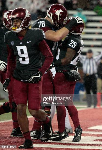 Jamal Morrow of the Washington State Cougars celebrates his touchdown against the Colorado Buffaloes with teammate Cody O'Connell in the second half...