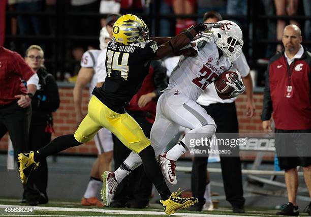 Jamal Morrow of the Washington State Cougars is pushed out of bounds by Ifo EkpreOlomu of the Oregon Ducks during the game at Martin Stadium on...