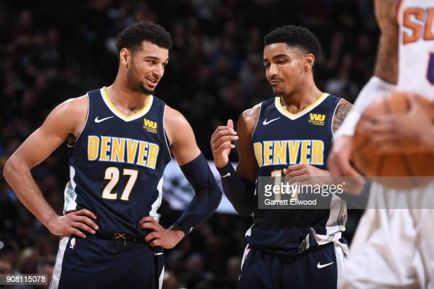 Jamal Murray and Gary Harris of the Denver Nuggets talk during the game against the Phoenix Suns on January 19 2018 at the Pepsi Center in Denver...