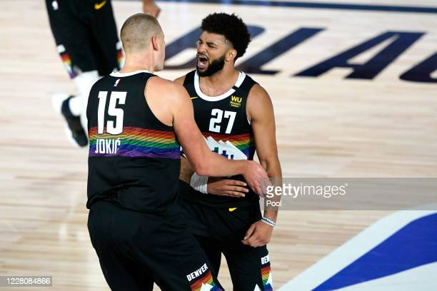 Jamal Murray and Nikola Jokic Denver Nuggets react during overtime of an NBA basketball first-round playoff game at The Field House at ESPN Wide...