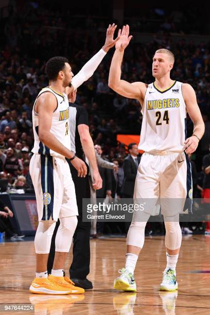 Jamal Murray of the Denver Nuggets and Mason Plumlee of the Denver Nuggets highfive during the game against the Portland Trail Blazers on APRIL 9...