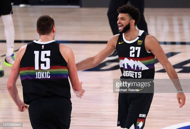 Jamal Murray of the Denver Nuggets and Nikola Jokic of the Denver Nuggets react during the fourth quarter against the LA Clippers in Game Six of the...