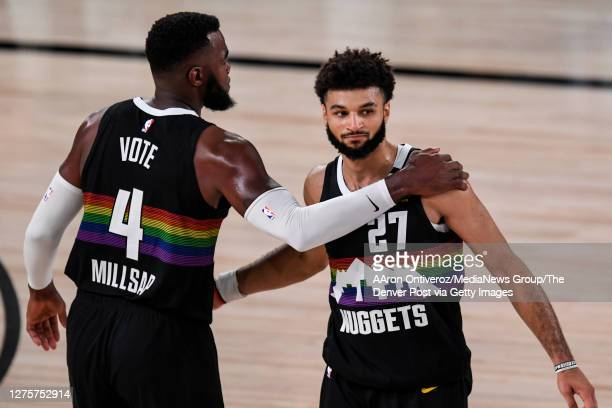 Jamal Murray of the Denver Nuggets and Paul Millsap celebrate a win agains the Los Angeles Lakers during the fourth quarter of Denver's 114-106 win...