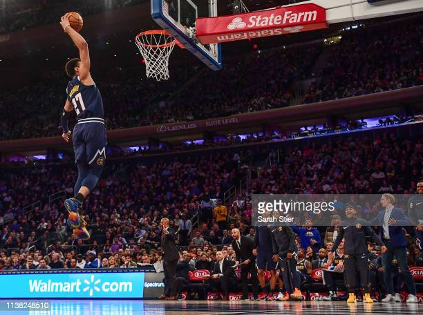 Jamal Murray of the Denver Nuggets attempts a slam dunk during the first half of the game against the New York Knicks at Madison Square Garden on...