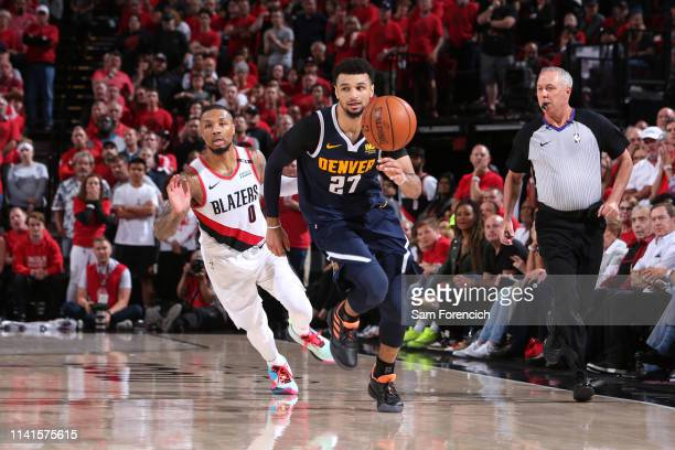 Jamal Murray of the Denver Nuggets avoids getting fouled against the Portland Trail Blazers during Game Four of the Western Conference Semifinals of...