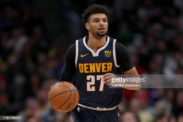 Jamal Murray of the Denver Nuggets brings the ball down the court against the Orlando Magic in the fourth quarter at the Pepsi Center on December 18...