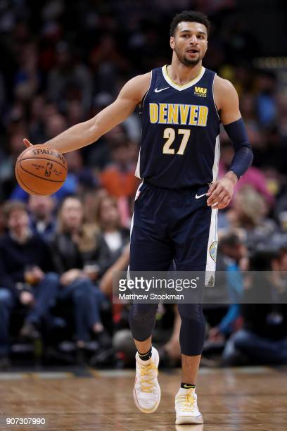 Jamal Murray of the Denver Nuggets brings the ball down the court against the Phoenix Suns at the Pepsi Center on January 19 2018 in Denver Colorado...