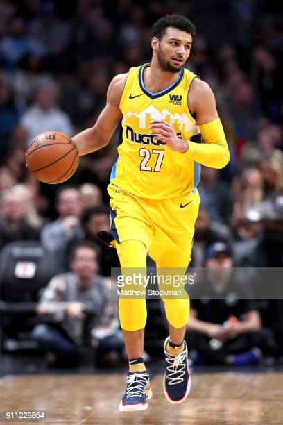Jamal Murray of the Denver Nuggets brings the ball down the court against the Dallas Mavericks at the Pepsi Center on January 27 2018 in Denver...