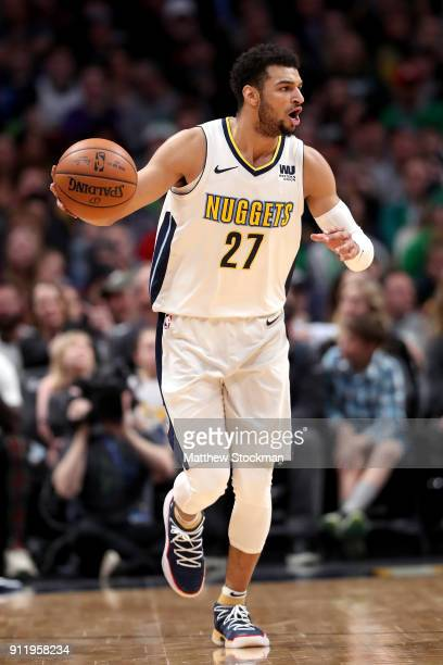 Jamal Murray of the Denver Nuggets brings the ball down the court against the Boston Celtics at the Pepsi Center on January 29 2018 in Denver...