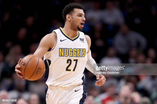 Jamal Murray of the Denver Nuggets brinmgs the ball down the court against the Dallas Mavaricks at the Pepsi Center on January 16 2018 in Denver...