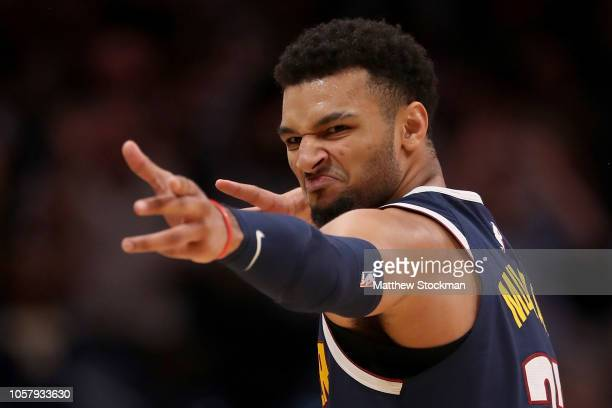 Jamal Murray of the Denver Nuggets celebrates a three point basket against the Boston Celtics in the fourth quarter at the Pepsi Center on November 5...