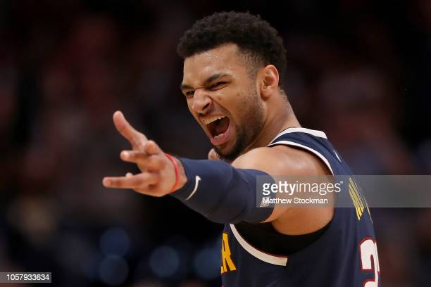 Jamal Murray of the Denver Nuggets celebrates a three point basket against the Boston Celtics in the fourth quarter at the Pepsi Center on November...