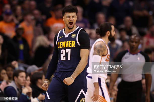 Jamal Murray of the Denver Nuggets celebrates after hitting a three point shot over Ricky Rubio of the Phoenix Suns during the second half of the NBA...