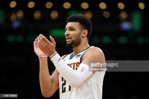Jamal Murray of the Denver Nuggets cheers on his teammates during the second half of the game against the Boston Celtics at TD Garden on March 18...
