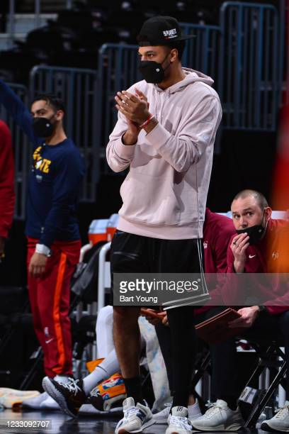 Jamal Murray of the Denver Nuggets cheers on the sidelines during the game against the Portland Trail Blazers during Round 2, Game 2 of the 2021 NBA...
