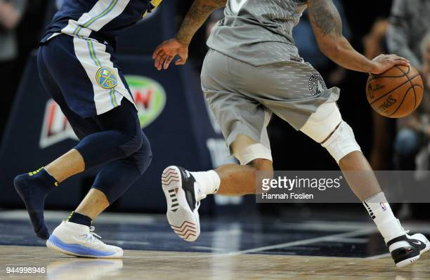 Jamal Murray of the Denver Nuggets defends Jeff Teague of the Minnesota Timberwolves with one shoe on during the fourth quarter of the game on April...
