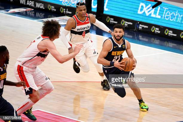 Jamal Murray of the Denver Nuggets dribbles in front of Robin Lopez of the Washington Wizards during the first half at Capital One Arena on February...