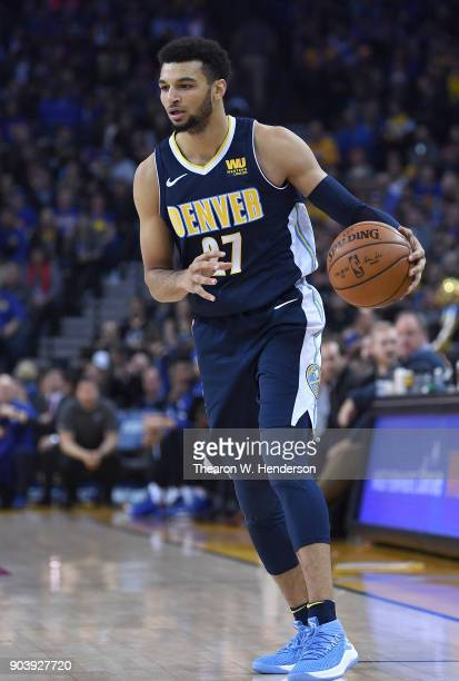 Jamal Murray of the Denver Nuggets dribbles the ball against the Golden State Warriors during an NBA Basketballl game at ORACLE Arena on January 8...