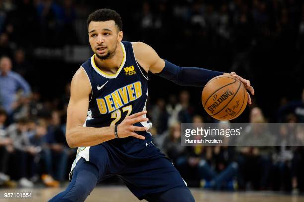 Jamal Murray of the Denver Nuggets dribbles the ball against the Minnesota Timberwolves during the game on April 11 2018 at the Target Center in...