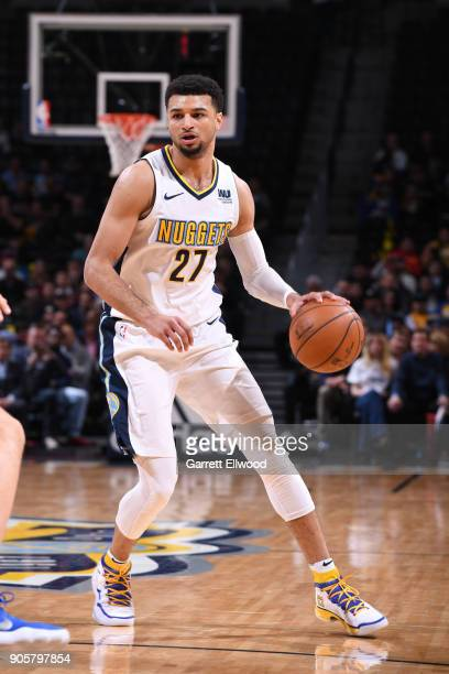 Jamal Murray of the Denver Nuggets dribbles the ball during the game against the Dallas Mavericks on January 16 2018 at the Pepsi Center in Denver...