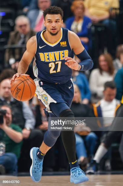 Jamal Murray of the Denver Nuggets dribbles the ball up court during the game against the Indiana Pacersat Bankers Life Fieldhouse on December 10...