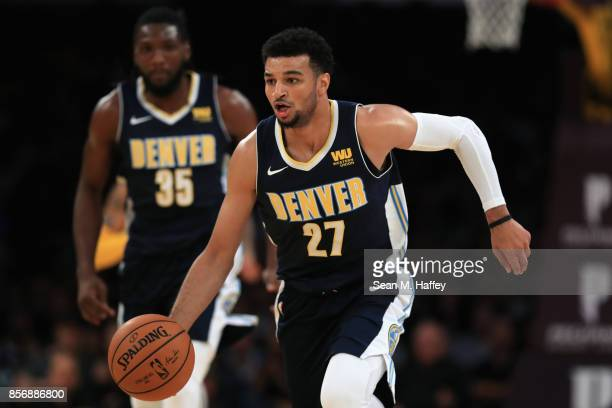 Jamal Murray of the Denver Nuggets dribbles upcourt during the second half of a preseason game against the Los Angeles Lakers at Staples Center on...