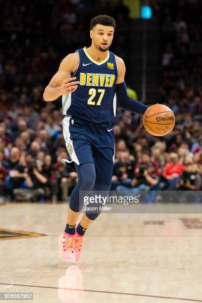 Jamal Murray of the Denver Nuggets drives down court against the Cleveland Cavaliers during the first half at Quicken Loans Arena on March 3 2018 in...