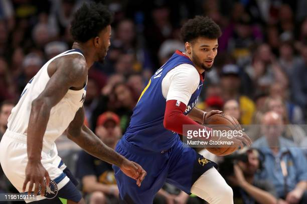 Jamal Murray of the Denver Nuggets drives down the court against Jordan Bell of the Minnesota Timberwolves in the fourth quarter at the Pepsi Center...
