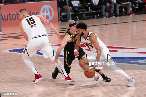 Jamal Murray of the Denver Nuggets drives in the game against Alex Caruso of the Los Angeles Lakers in Game two of the Western Conference Finals of...