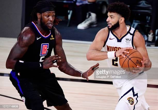 Jamal Murray of the Denver Nuggets drives the ball against Montrezl Harrell of the LA Clippers during the fourth quarter in Game Seven of the Western...