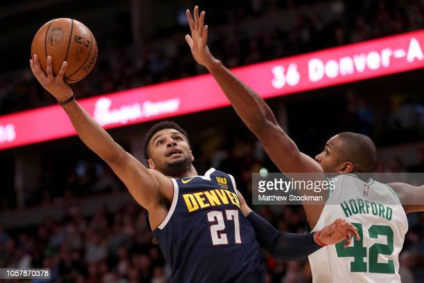 Jamal Murray of the Denver Nuggets drives to the basket against Al Horford of the Boston Celtics in the first quarter at the Pepsi Center on November...