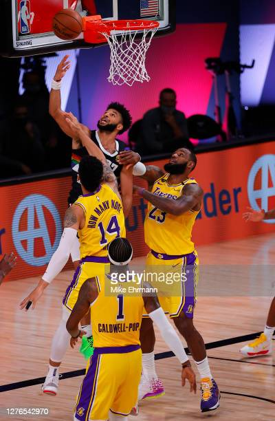 Jamal Murray of the Denver Nuggets drives to the basket against Danny Green of the Los Angeles Lakers and LeBron James of the Los Angeles Lakers...