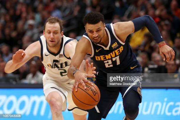 Jamal Murray of the Denver Nuggets drives to the basket against Joe Ingles of the Utah Jazz in the first quarter at the Pepsi Center on November 3...