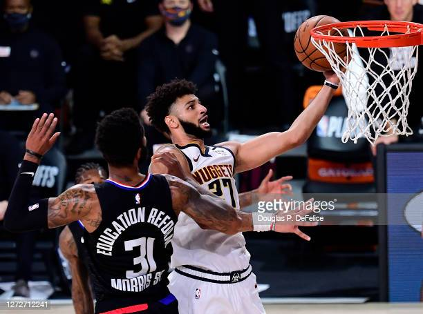 Jamal Murray of the Denver Nuggets drives to the basket against Marcus Morris Sr. #31 of the LA Clippers during the second quarter in Game Seven of...