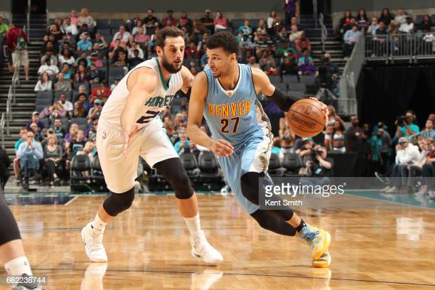 Jamal Murray of the Denver Nuggets drives to the basket against the Charlotte Hornets on March 31 2017 at Spectrum Center in Charlotte North Carolina...