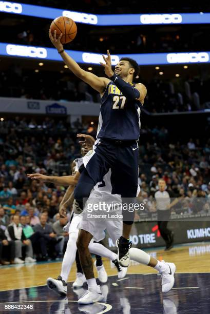 Jamal Murray of the Denver Nuggets drives to the basket against the Charlotte Hornets during their game at Spectrum Center on October 25 2017 in...