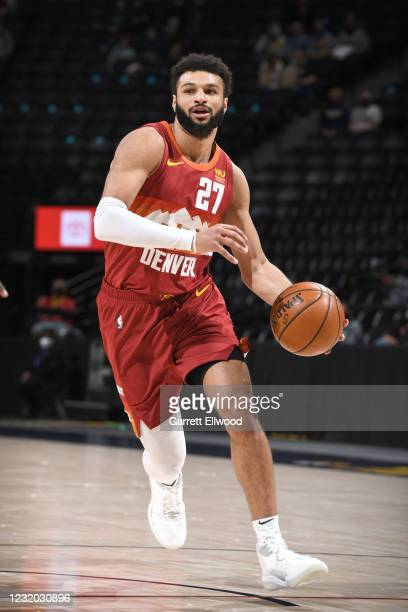 Jamal Murray of the Denver Nuggets drives to the basket during the game against the Philadelphia 76ers on March 30, 2021 at the Ball Arena in Denver,...
