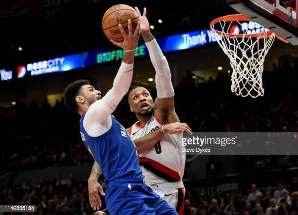 Jamal Murray of the Denver Nuggets drives to the basket on Damian Lillard of the Portland Trail Blazers during the second half of game three of the...