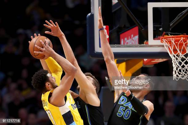 Jamal Murray of the Denver Nuggets goes to the basket against Maxi Kleber and Salah Mejri of the Dallas Mavericks at the Pepsi Center on January 27...