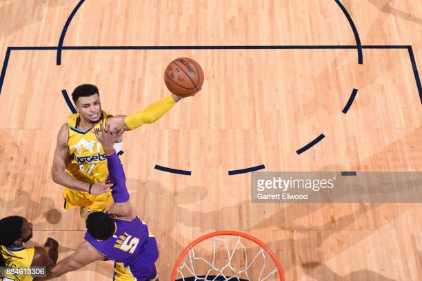 Jamal Murray of the Denver Nuggets goes to the basket against the Los Angeles Lakers on December 2 2017 at the Pepsi Center in Denver Colorado NOTE...